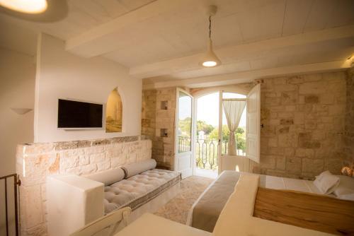 A seating area at Resort La Corte Dell'Astore - Wild in Style Resort