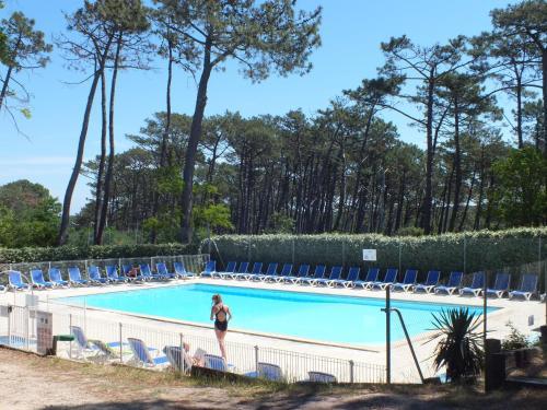 The swimming pool at or near Camping de la Dune