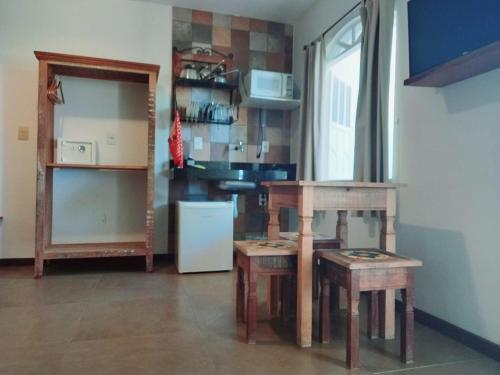 A cozinha ou cozinha compacta de Pousada Ilha da Saudade