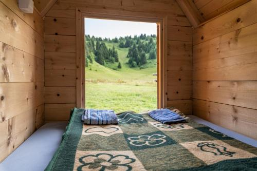 A bed or beds in a room at Kamp Janketic