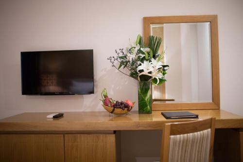 A television and/or entertainment center at Diamond Sea Hotel