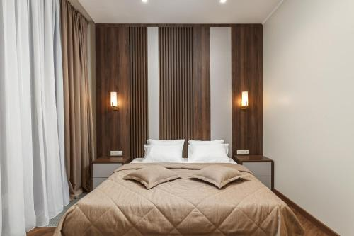 A bed or beds in a room at KIGO Moscow City