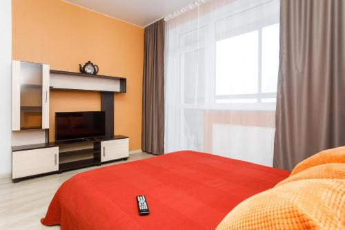 A bed or beds in a room at EtazhiDaily at Studencheskaya