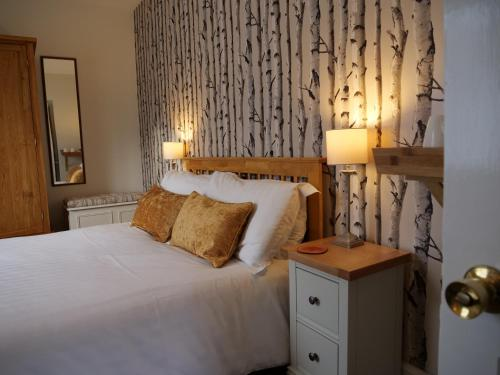 A bed or beds in a room at Windrush House