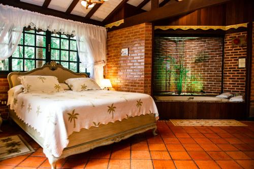 A bed or beds in a room at Urikana Boutique Hotel