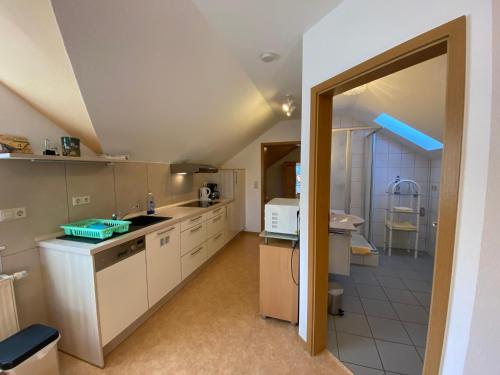 A kitchen or kitchenette at Birnbaumhof - Hotel Pension und Ferienwohnungen