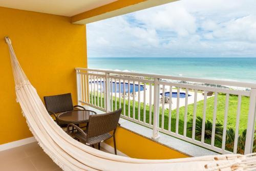 A balcony or terrace at Hotel Senac Barreira Roxa