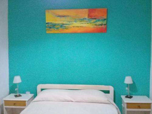 A bed or beds in a room at La Solita