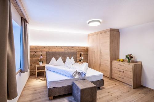 Ein Bett oder Betten in einem Zimmer der Unterkunft Apartments Heidenberger Delle Scuole