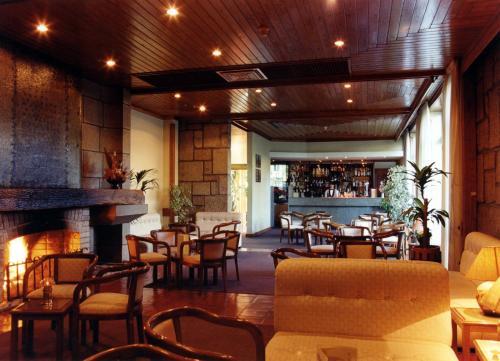 A área de bar ou lounge em Hotel Senhora do Castelo