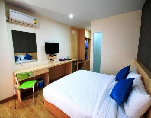 A bed or beds in a room at S3 Residence Park