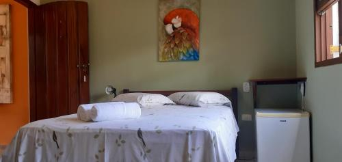 A bed or beds in a room at Pousada Villa Verano