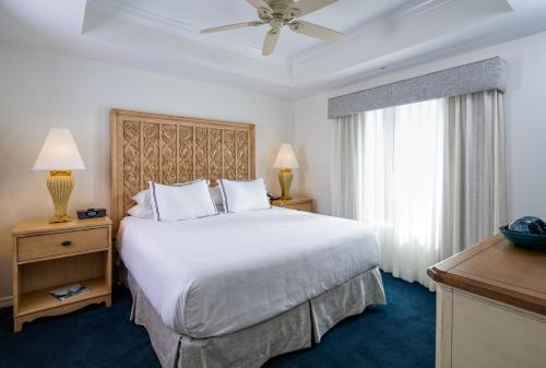 A bed or beds in a room at Bellasera Resort