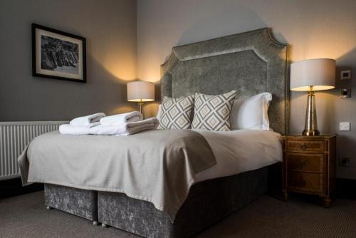 A bed or beds in a room at Kinnettles Hotel