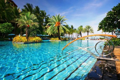 The swimming pool at or near Dusit Thani Hua Hin