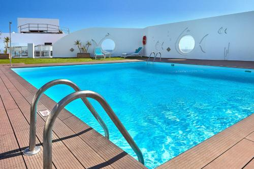 The swimming pool at or near Hotel Lancelot