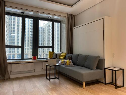 A seating area at Premium apartment Match Point