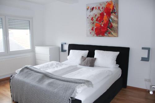 Ein Bett oder Betten in einem Zimmer der Unterkunft Victoria Apartments