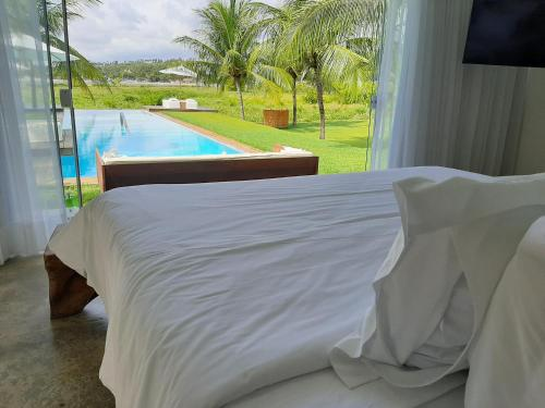 A view of the pool at Pe na Areia Boutique Hotel or nearby
