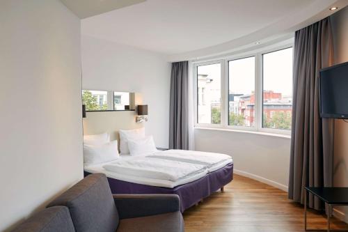A bed or beds in a room at Scandic Berlin Kurfürstendamm