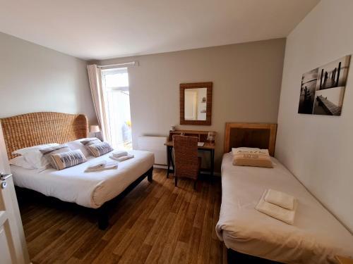 Un ou plusieurs lits dans un hébergement de l'établissement Hotel La Chaize
