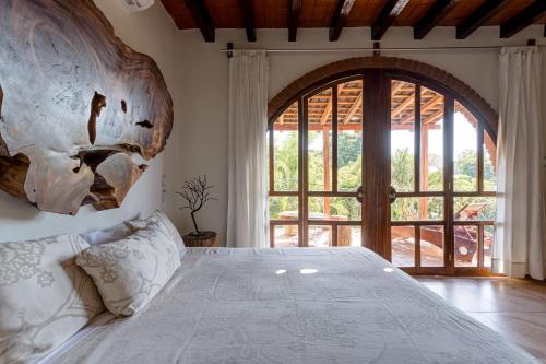 Cama o camas de una habitación en Suites La Hacienda