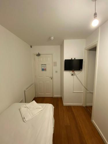 A bed or beds in a room at Contractors Guest House