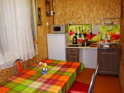 Кухня или мини-кухня в Гостевой дом КартошКино