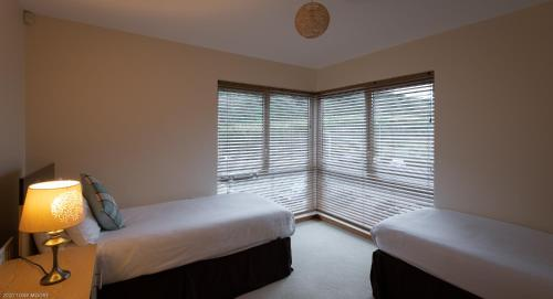 A bed or beds in a room at Westville Apartments