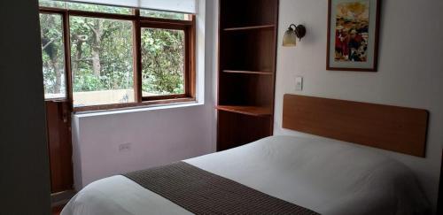Cama ou camas em um quarto em Hostal Posada del Maple