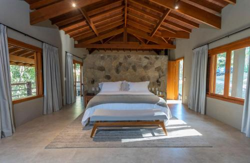A bed or beds in a room at Canto do Irere - Boutique Hotel