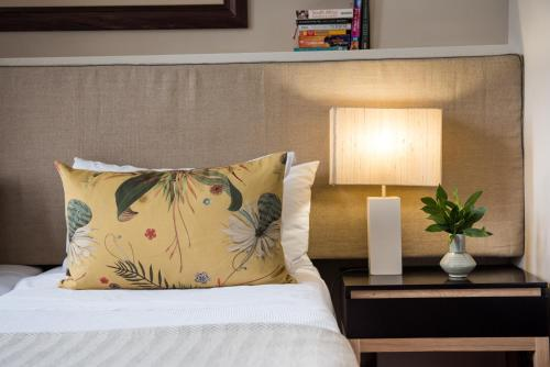 A bed or beds in a room at Welgelegen
