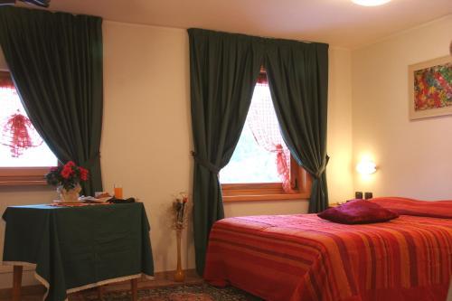 Postel nebo postele na pokoji v ubytování Hotel La Colombina