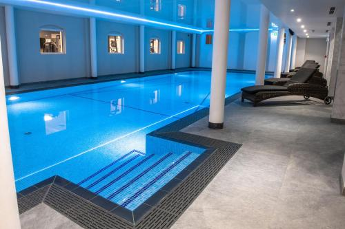 The swimming pool at or near Cottesmore Hotel Golf & Country Club