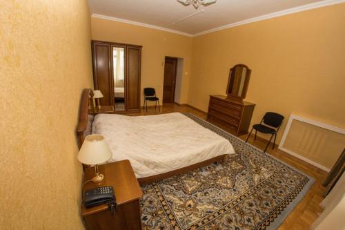 Кровать или кровати в номере Оздоровительный Комплекс «Сосны»