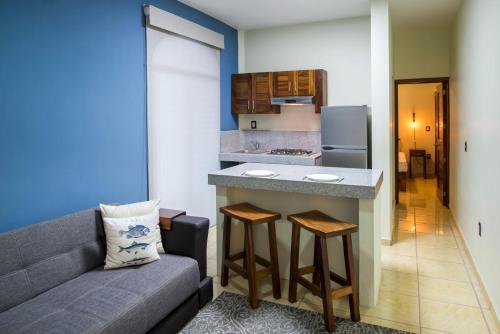 A kitchen or kitchenette at Punto Mita Suites