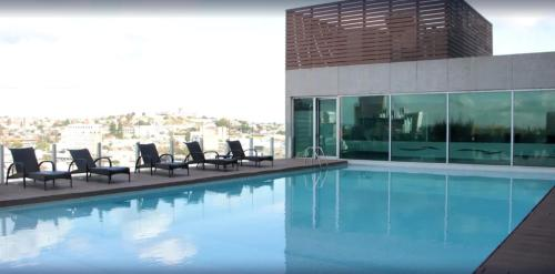 The swimming pool at or near Rivera Casino & Resort