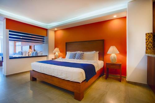 A bed or beds in a room at The Paramar Beachfront Boutique Hotel With Breakfast Included - Downtown Malecon