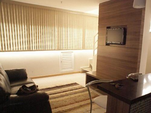 A seating area at Duplex Apto Setor Hoteleiro Norte