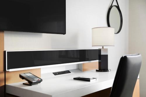 A television and/or entertainment center at Delta Hotels by Marriott Calgary Downtown