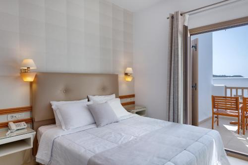 A bed or beds in a room at Lithos by Spyros & Flora