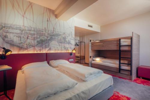 A bunk bed or bunk beds in a room at Campanile Berlin Brandenburg Airport