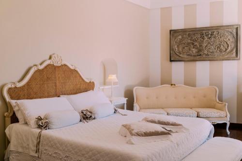 Letto o letti in una camera di Villa Mary Suites