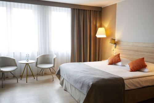 Cama ou camas em um quarto em Scandic Wroclaw