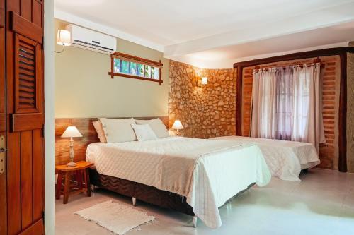 Cama ou camas em um quarto em Pousada Fruta Pão