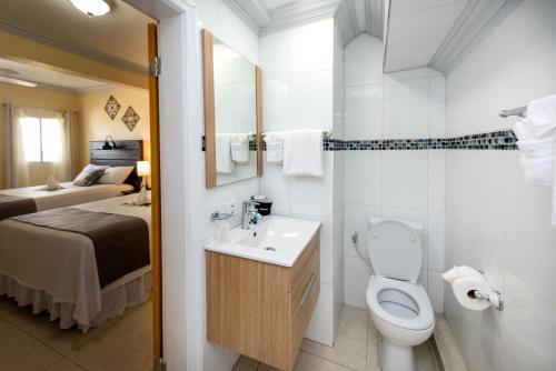 A bathroom at Baker's Suites
