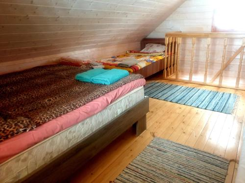 A bed or beds in a room at Juba Holiday House