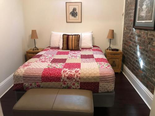 A bed or beds in a room at The Courtyards
