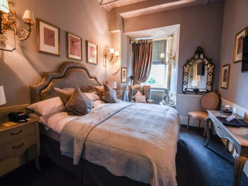 A bed or beds in a room at Lumley Castle Hotel