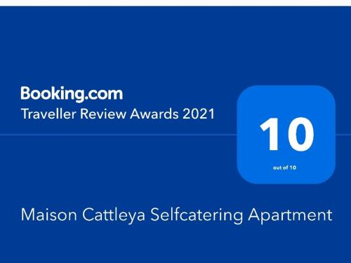 A certificate, award, sign or other document on display at Maison Cattleya Selfcatering Apartment